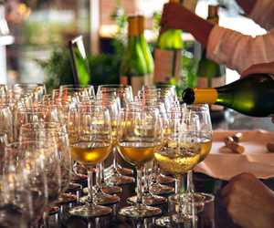 Pouring chardonnay for a catered event
